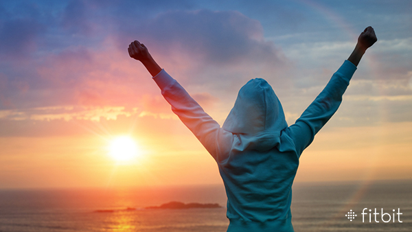Sport and life achievements and success concept. Rear view sporty girl raising arms towards beautiful glowing sunshine.; Shutterstock ID 165529670; PO: license(14259)